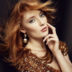 Attractive redhead beauty posing