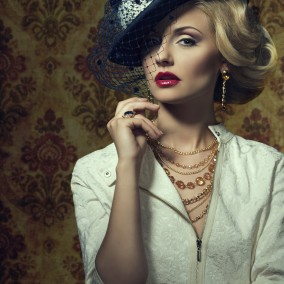 Young woman with vintage style in jewelry